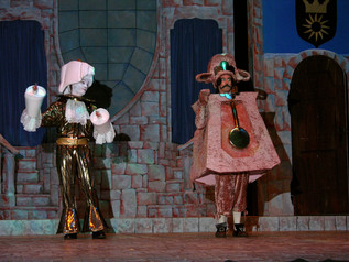 Wesley Thomas as Lumiere and Bernie Lanigan as Cogsworth