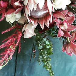 protea and orchid bouquet