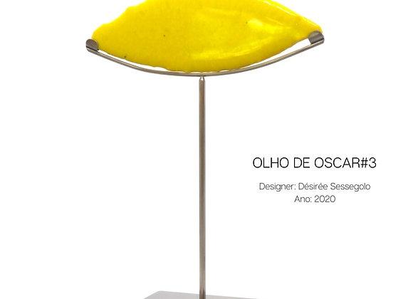 Olho de Oscar, escultura em vidro e aço inox de Désirée Sessegolo
