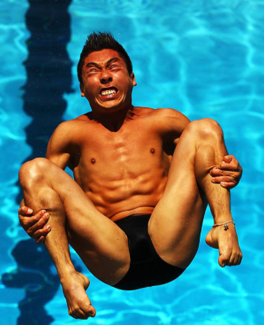 Olympic diver photo mid flight