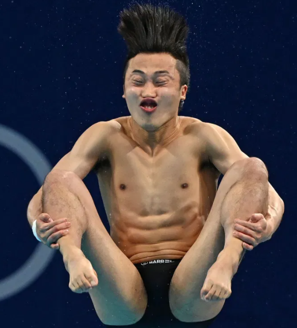 Olympic Diver with funny face and hair flying upwards