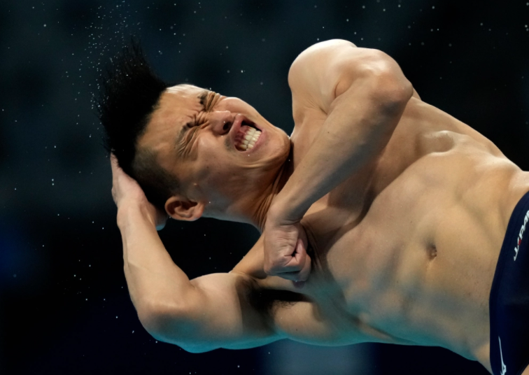 Olympic diver pulling funny face with hand on head