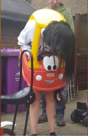 Lady gets stuck in kids toy car