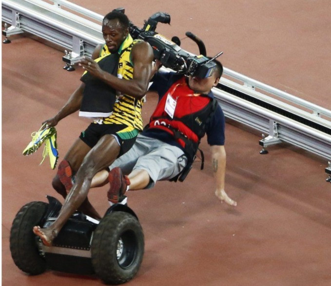 Usain Bolt falling over with camera man