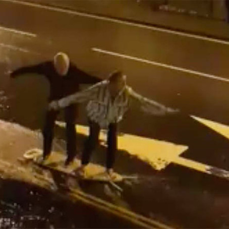 Old Couple Go Surfing On Ironing Board in The Rain