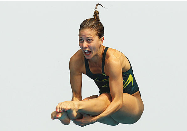 Female Olympic Diver Mid Flight