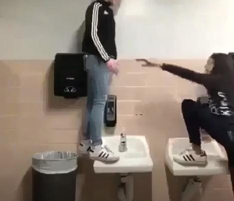 Girls standing on sink