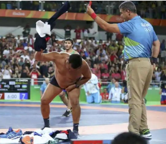Mongolian Wrestling Coach Stripping Down To His Undies