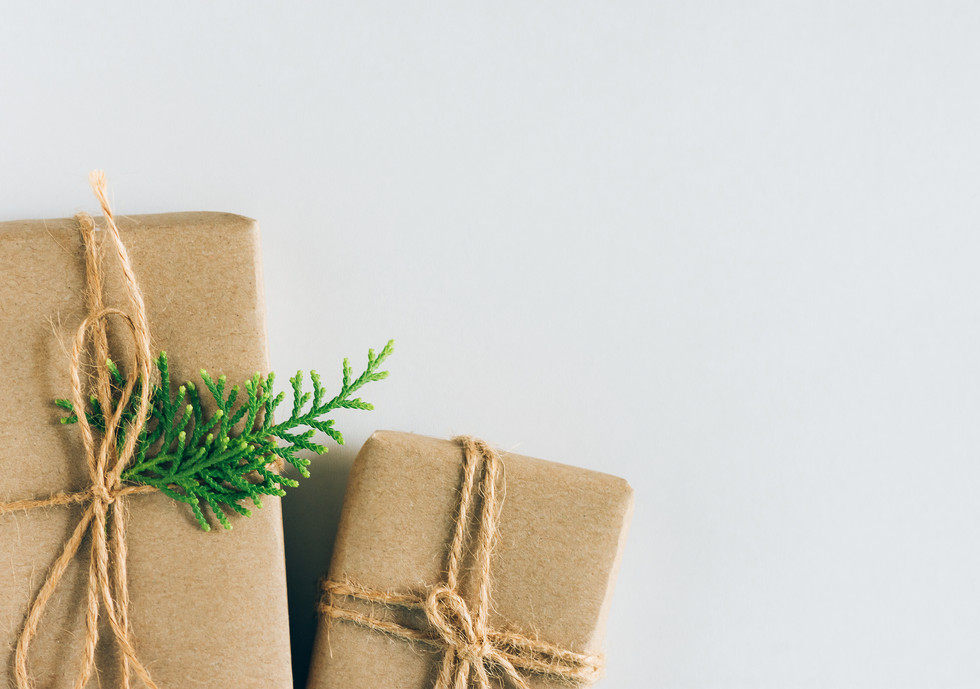 Canva - Two Gift Boxes Wrapped in Craft