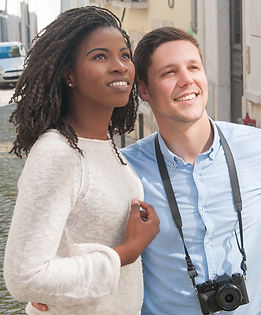 smiling-young-interracial-couple-sightse