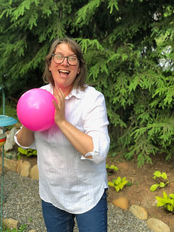image of sarah holding a pink ball smiling