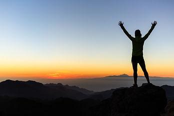 woman-climber-success-silhouette-in-moun