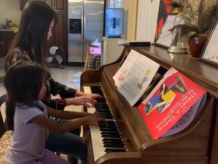 5-year old learning piano