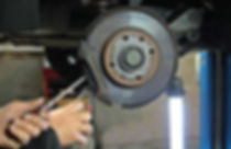 Disc brake being repaired photo