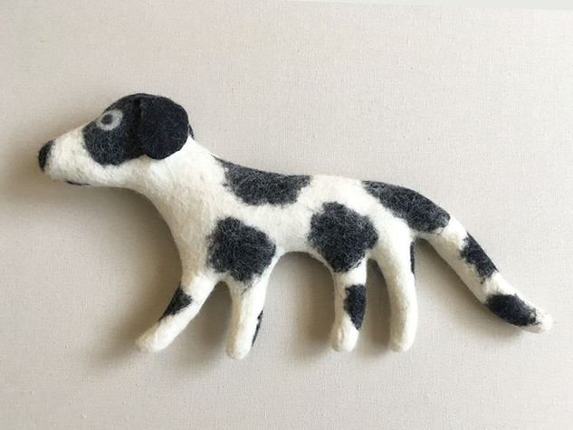 White Dog with Black Spots