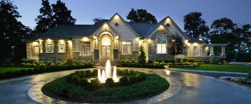 This custom Savignon Blanc custom home is highlighted beautifully by its outdoor lighting scheme and illuminated fountain