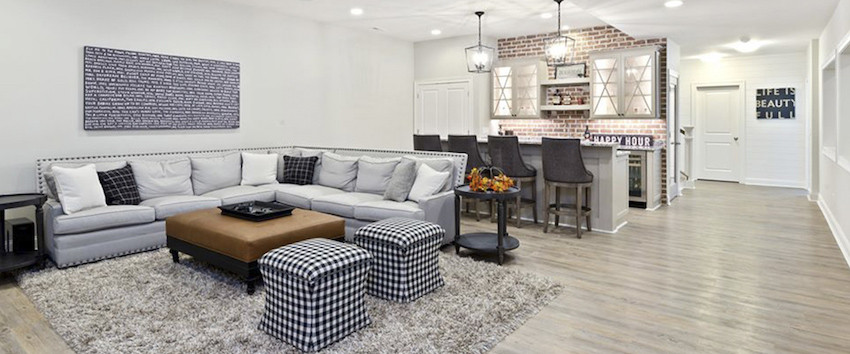 Custom finished basement layout with wet bar and entertainment space