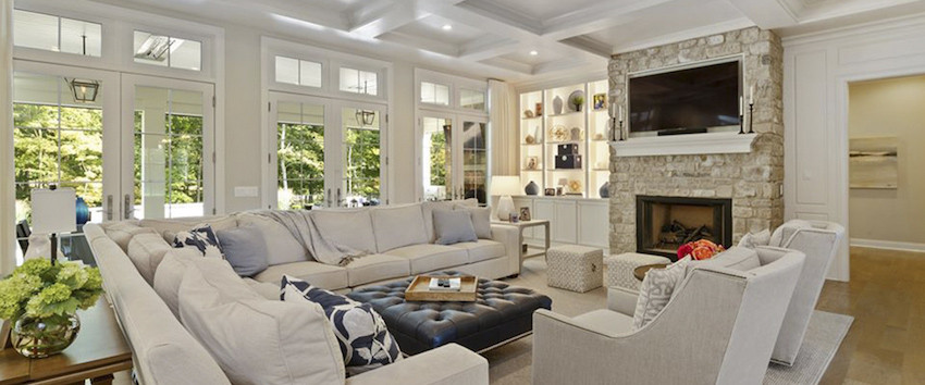 A wall of windows pours daylight into this refreshing custom great room design by Robert Lucke Homes