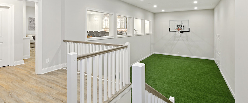 Indoor basketball court of a custom first floor master home in Indian Hill, Ohio