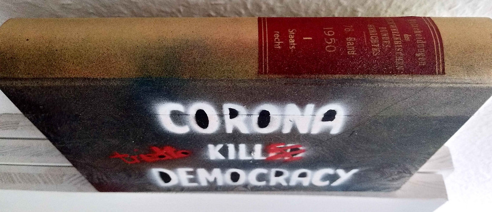 "Antonio Wehrli - sideview Limited edition individually sprayed law book ""Corona tried to kill Democracy"""