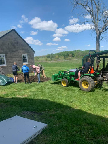 Residents prepare to fill the gardening boxes