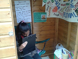 Young woman writes in the WordShed photo
