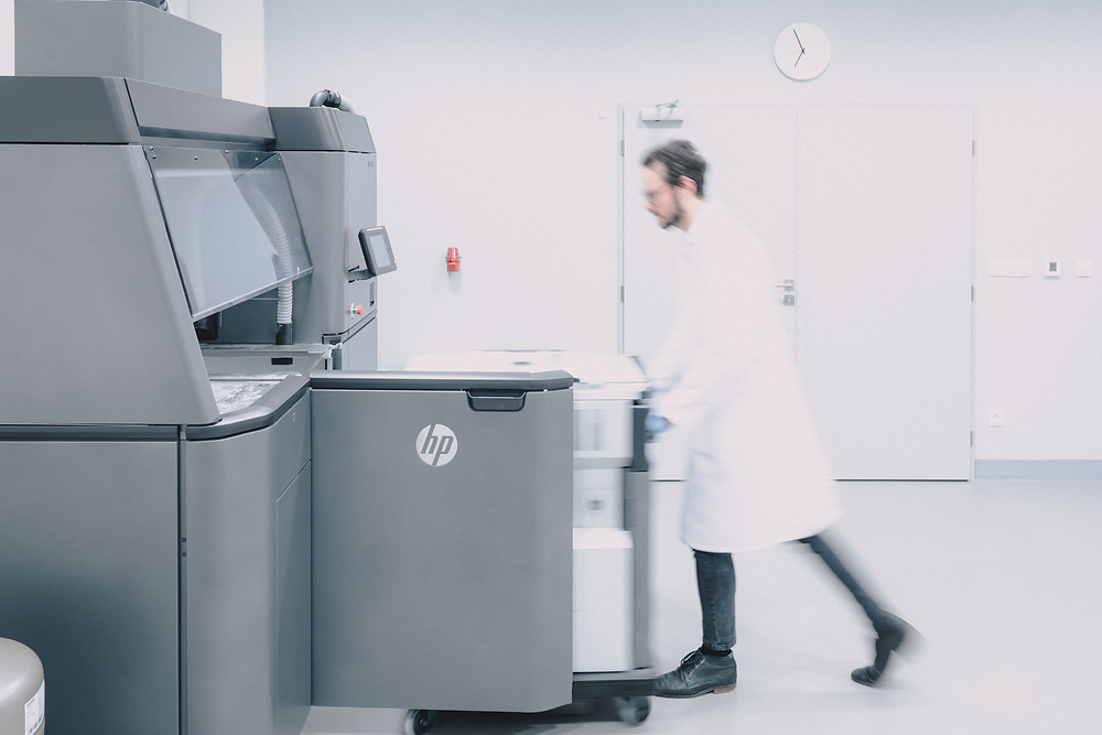 Man approaching HP 3d printer
