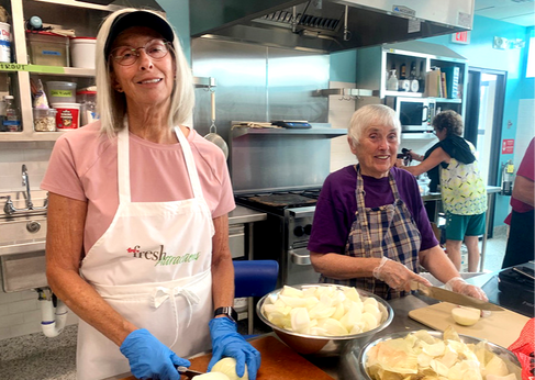 1Sue Futterer, Mary Sanders—Chopping onions (Sue Nordman & Jerry Wilkes in the background)
