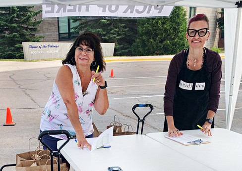 1Jeanne Spry & Heidi Doo-Kirk, parking lot distribution team (with Rich Palmer).jpg