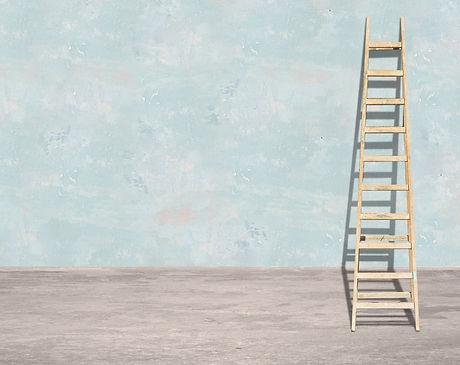 Ladder leaning against a wall.jpg