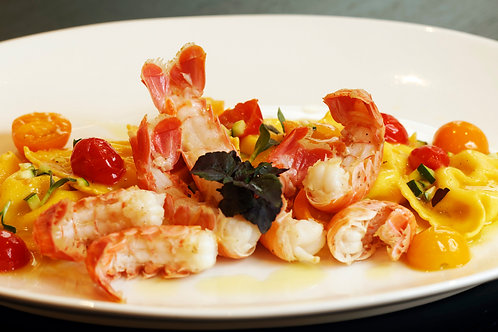Langoustines Busara style (hot tomato sauce) and rise with herbs