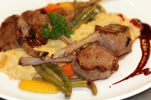 Lamb cutlet with pomegranate and oranges accompanied by polenta & vegetables