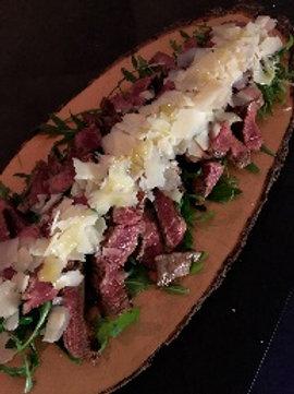 Tagliata Black Angos Beef (IRL) with new potatoes, rocket and Parmesan slivers (