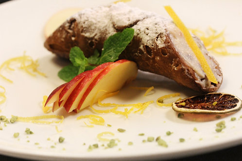 Sicilian cannolo with ricotta cheese and chocolate shaves