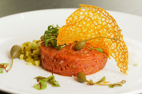 "Tartar of ""Fassona beef"" (mild, medium, spicy) with focaccia and butter"