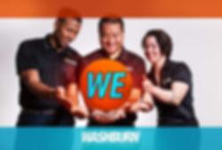 WE Team holding logo.JPG