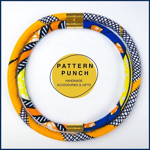 Fabric rope necklace in yellows, blue and orange
