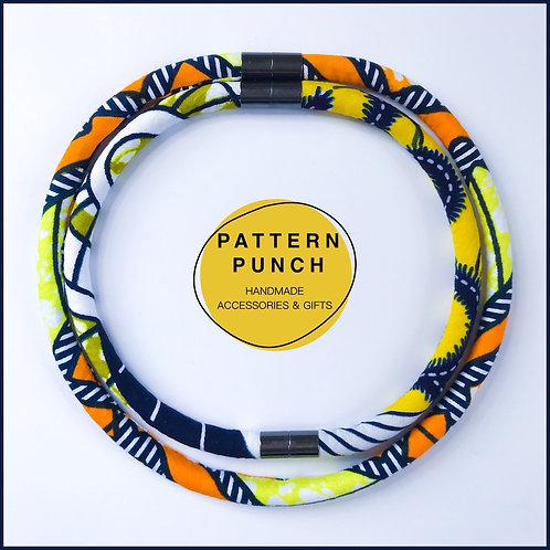 Lightweight fabric rope necklace set in African wax print fabric with magnetic clasp in orange & yellow. Pattern Punch