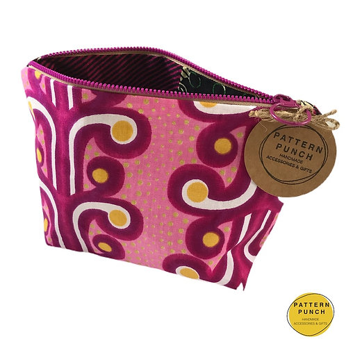 Pattern Punch African wax print fabric zip up bag in pink design