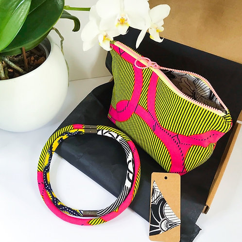 Gift set image of necklace and zip up bag with gift tag.  In bright yellow and pink fabrics