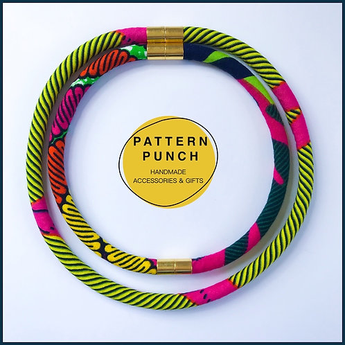 Lightweight fabric rope necklace set in African wax print fabric with magnetic clasp in pink, yellow and green. Pattern Punch