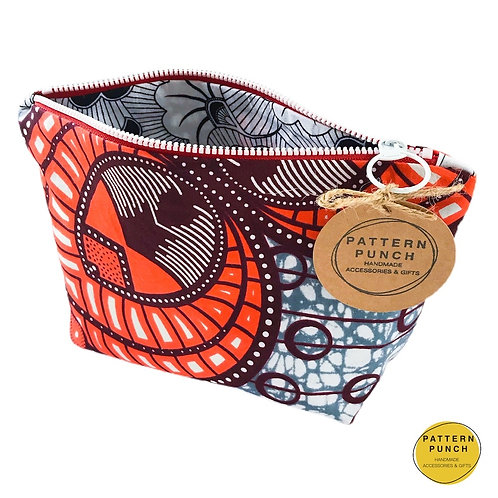 Pattern Punch African wax print fabric zip up bag in red and grey design