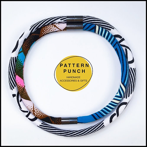 Lightweight fabric rope necklace with magnetic clasp in black, white and blue African print fabrics.