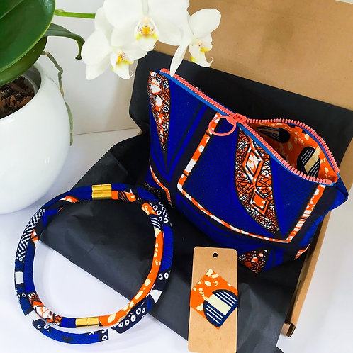 Gift set image comprising of zip up bag and necklace in complementary colours - blues and oranges