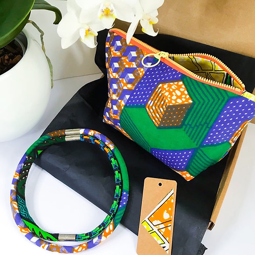 Gift set image of necklace set, zip up bag and gift tag  in green,  orange and blue wax print fabric designs