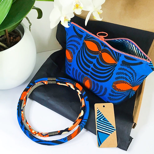 Gift set image of zip up bag, necklace and gift tag in orange and blue African wax print fabrics