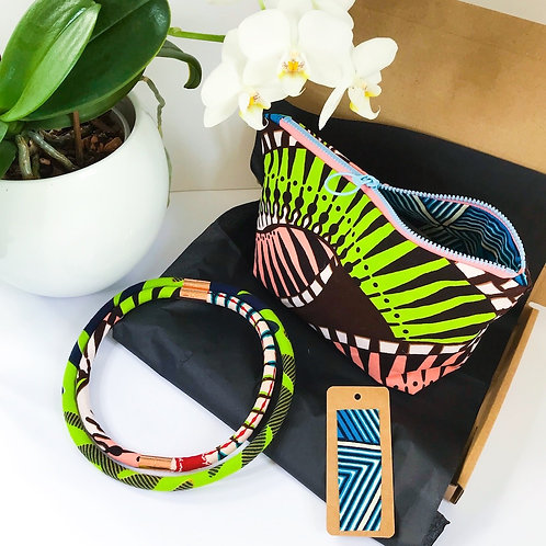 Gift set image comprising of zip up bag and necklace in complementary colours - greens and coral African wax print fabrics
