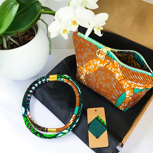 Showing the items included in the gift set image of a necklace and a zip up bag in green tones and African wax print fabric
