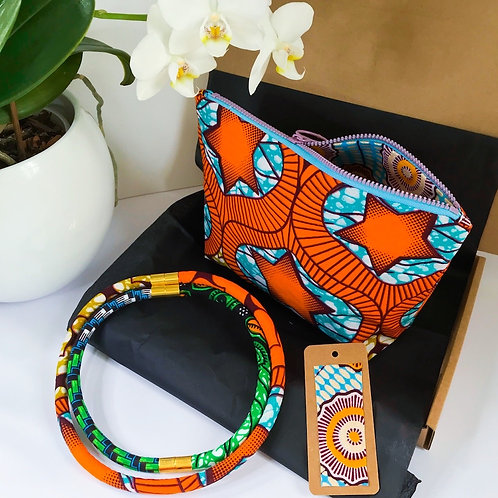 Gift set image of necklace set, zip up bag and gift tag  in orange and turquoise wax print fabric designs