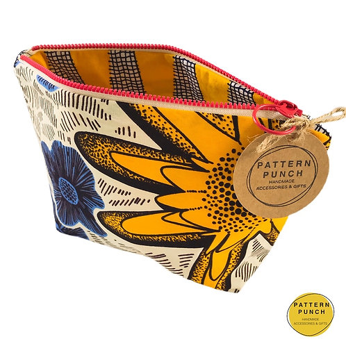 Pattern Punch zip up bag in African wax print fabrics yellow and blue flower design